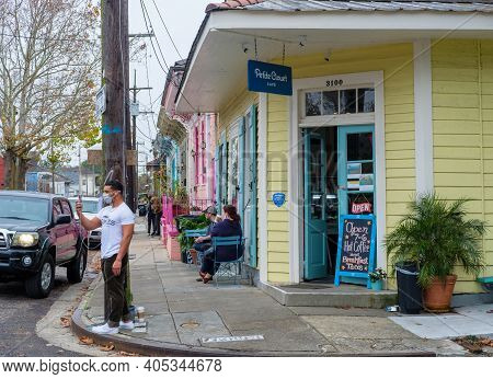 New Orleans, La - January 23: Patrons And Entrance To Petite Clouet Cafe On January 23, 2021 In New