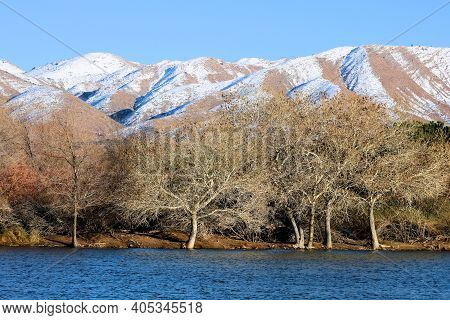 Lake Surrounded By Barren Hills Covered With Snow Taken At The Mojave Desert In Hesperia, Ca