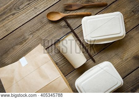 Disposable Eco Friendly Packaging Containers With Paper Cup And Craft Paper Food On Wooden Table At