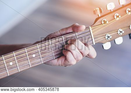 Man Hands Playing Acoustic Guitar, Close Up Chord Guitar Player Musical Instrument For Recreation Or