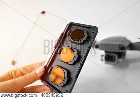 Female Hand Holding Nd Filters And Polarising Filters Set For Drone. Filters For The Drone Camera.