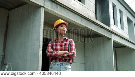 Portrait Of Young Asian Woman Engineer Safety Equipment At Construction Site. Plan Of Construction S