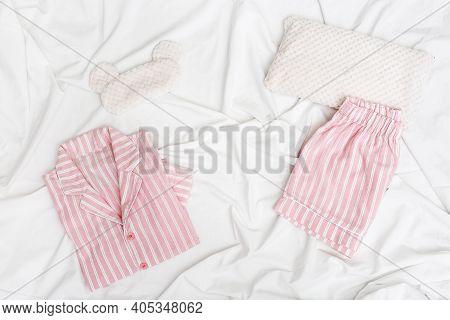 Sleepwear For Slumber. Pink Women Pajama With Stripes, Shirt And Shorts. Sleeping Mask On White Shee