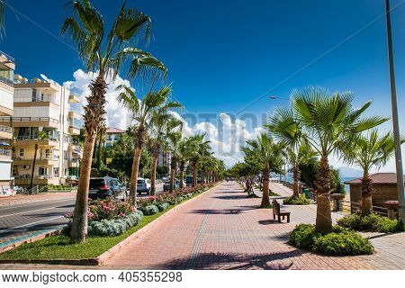 Alanya , Turkey- October 20, 2020: Alanya promenade - Ahmet Tokus Boulevard along all Beaches. Tourists promenade along the alley along the Mediterranean coast. Alanya, Turkey