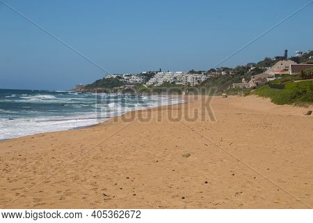 Stretch Of Beach With Residential Buildings Off Shoreline