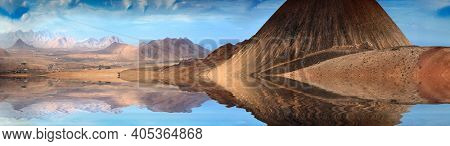 Mountain range and the reflection in the water lake