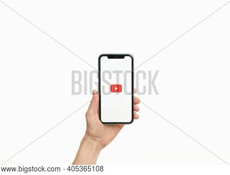 Mykolaiv, Ukraine - July 9, 2020: Woman Holding  Iphone X With Youtube App On White Background, Clos
