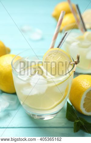 Natural Lemonade On Light Blue Wooden Table, Closeup. Summer Refreshing Drink