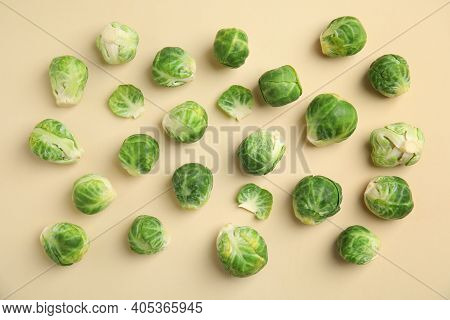 Fresh Brussels Sprouts On Beige Background, Flat Lay