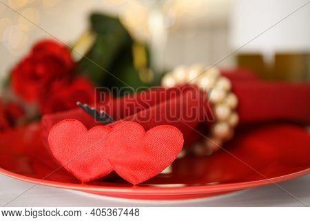 Elegant Place Setting For Romantic Dinner On White Table, Closeup. Valentine's Day Celebration