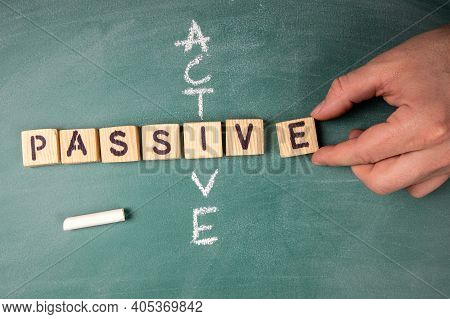 Passive And Active. Text From Letters Of The Wooden Alphabet