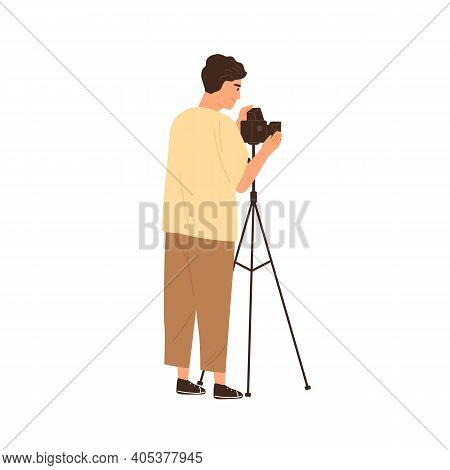 Professional Male Photographer Adjusting Film Photo Camera On Tripod And Taking Pictures. Young Came