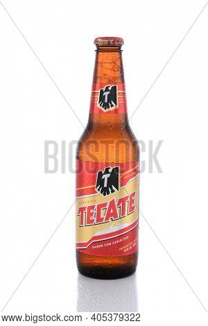 IRVINE, CA - JUNE 14, 2015: Tecate Beer Bottle. A single bottle of Tecate Cerveza, a popular pale lager named after the city of Tecate, Baja California, where it was first produced in 1943.