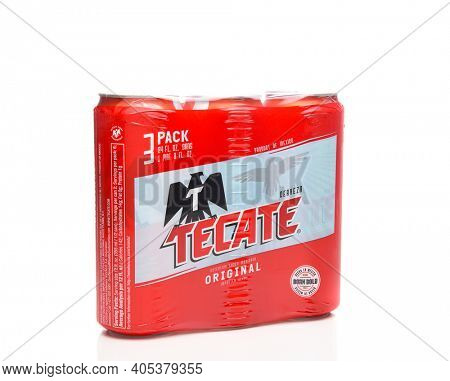 IRVINE, CALIFORNIA - MARCH 21, 2018: A 3 pack of Tecate Original Cerveza 24 ounce cans. Cuauhtemoc Moctezuma Brewery is a major brewer based in Monterrey, Nuevo Leon, Mexico, founded in 1890.