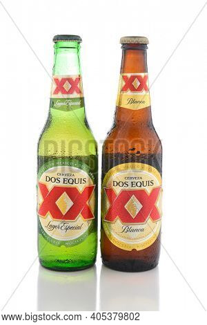 IRVINE, CA - JUNE 14, 2017: Dos Equis Blanca and Especial. Two bottles the beer from Cuauhtemoc-Moctezuma Brewery in Monterrey, Mexico a subsidiary of Heineken International.