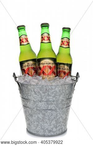 IRVINE, CA - MAY 25, 2014: Three Bottles of Dos Equis Lager Especial in a bucket of ice.