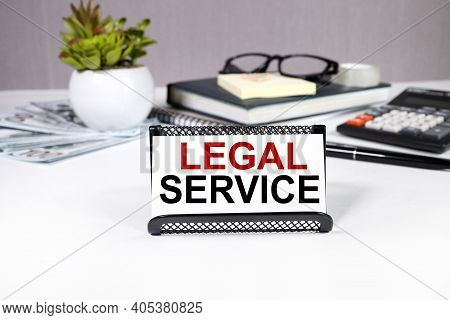 Legal Service, Text On White Paper, On Notepad Paper, On Light Background