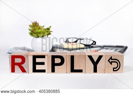 Reply. Text On Wood Cubes On A Light Background.