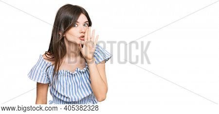 Young beautiful caucasian girl wearing casual clothes hand on mouth telling secret rumor, whispering malicious talk conversation