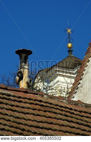 Typical Chimney In Old Tile Roof With Belfry On Background. Szentendre, Hungary