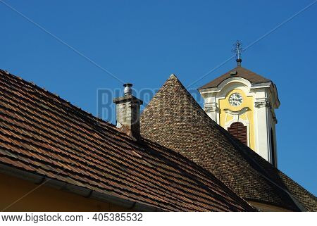 Old Tile Roof With Typical Chimney And Belfry On Background. Szentendre, Hungary