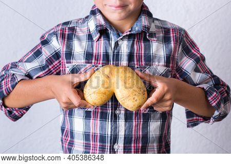 Trendy Ugly Vegetable, Human Lungs Shaped Potato In Hands