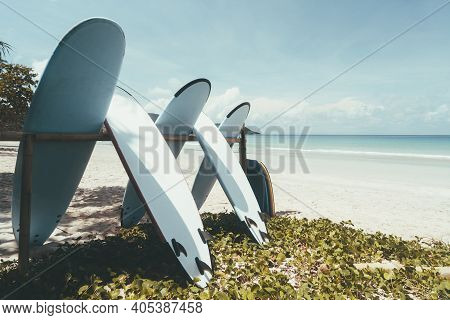 Surfboard On Tropical Beach With Blue Sky Background. Summer Vacation And Sport Extreme Concept. Vin