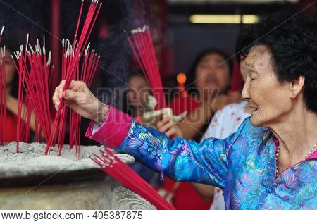 Jakarta, Indonesia - January 29, 2017: Chinese Elder Burn The Incense In Chinese Lunar New Year Cele