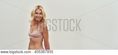 Beautiful At Any Age. Happy Gorgeous Middle Aged Blonde Woman In Lingerie Smiling At Camera While Po