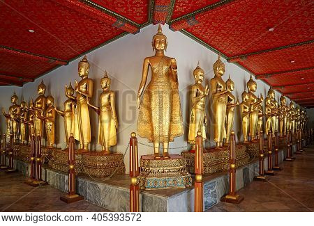 Rows Of Stunning Gilded Buddha Images From Different Parts Of Thailand Along The Cloisters Of Wat Ph