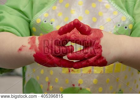 Hands Of A Child In Red Paint, Close-up. Concept: Development Of Creativity In Children, Drawing Wit