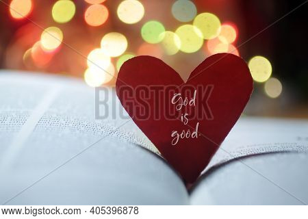 Inspirational Quote On A Red Heart - Pray More, Worry Less. On Open Bible Book Page And Colorful Bok