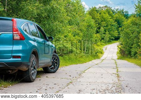Suv On The Concrete Roadside In The Forest. Travel Countryside Concept. Beautiful Nature Scenery In