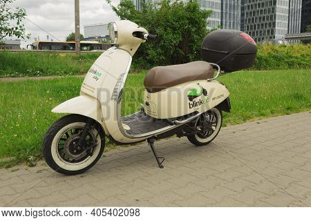 Warsaw, Poland - June 16, 2020: Economical And Environmentally Friendly Moped. Electric Moped As An