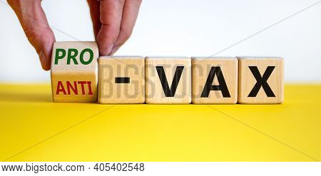 Pro-vax Or Anti-vax Symbol. Doctor Turns A Cube, Changes Words 'anti-vax' To 'pro-vax'. Beautiful Ye