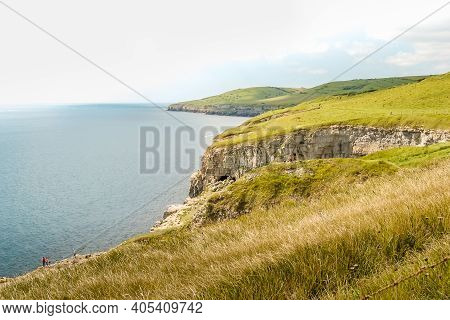 Looking West Along The Beautiful Jurassic Coast On A Summer Afternoon From A Cliff Top Path Near The