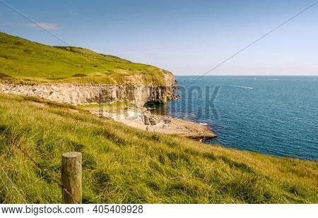 Looking East Along The Rocky Jurassic Coast From A Cliff Top Coastal Path With The Dancing Ledge, La