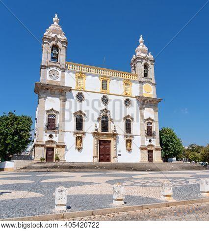Catholic Church Named Igreja Do Carmo In Faro, Portugal. Taken With A Clear Blue Sky In The Backgrou