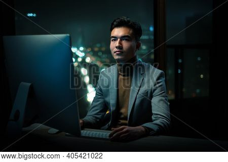 Thoughtful Man Work Night Shift at Office