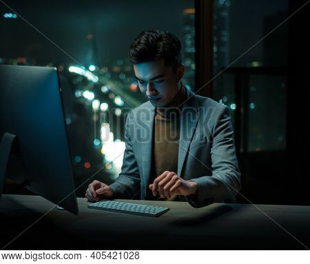 Young Businessman Write Emails on Computer