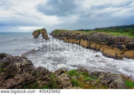 Castro De Las Gaviotas View In Asturias, With Iconic Rock Formation