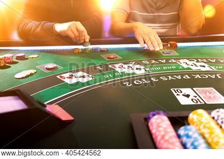 Men playing BlackJack at the casino table - Shallow depth of field