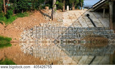 Small Rock Dam To Protection Erosion Brae From Wave Of River.