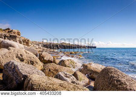 The Rocky Coastline Of Portland Bill, Isle Of Portland, Dorset, Uk On A Clear Blue, Warm, Summer Mor