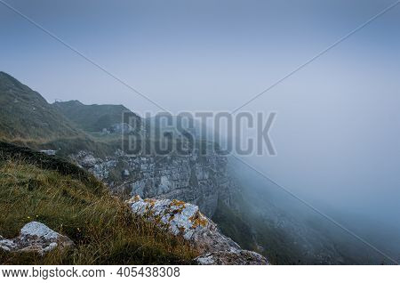 Cliff Top View Of The Jurassic Coast Cliffs During Foggy Weather Near Tout Quarry, Isle Of Portland,
