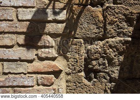 Volterra (si), Italy - April 25, 2017: A Typical Tuscany Brick Wall In Volterra Town, Tuscany, Italy