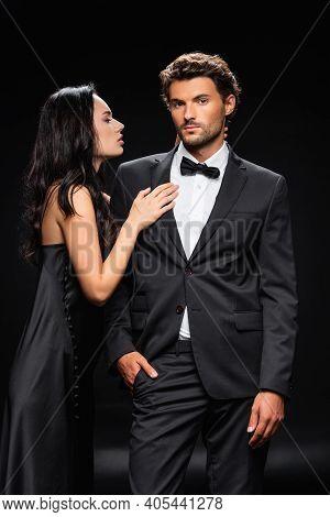 Seductive Brunette Woman Seducing Elegant Confident Man Isolated On Black.