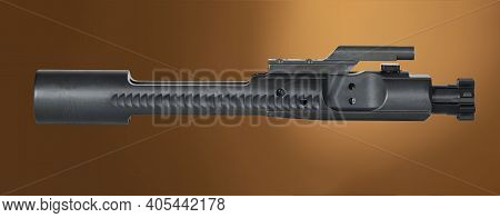 Tan Background With A Black Ar-15 Bolt Carrier Group Above