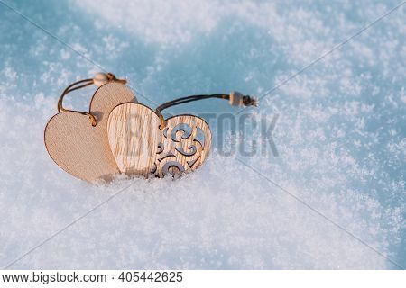 Couple Of Wooden Hearts In Cold, Frosty Morning Snow. Valentines Day Greeting Card. Symbol Of Love A
