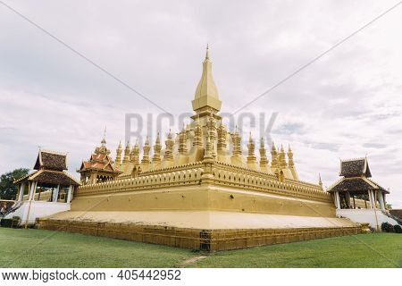 Golden Pha That Luang Temple, Vientiane, Laos With Overcast Skies.